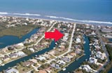 An aerial view of the canal homes and their proximity to the ocean at Flagler Beach, Florida.