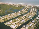 An aerial view of some canal homes in Flagler Beach and their proximity to the ocean and the Intracoastal Waterway.